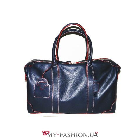 Вместительная сумка синего цвета на молнии