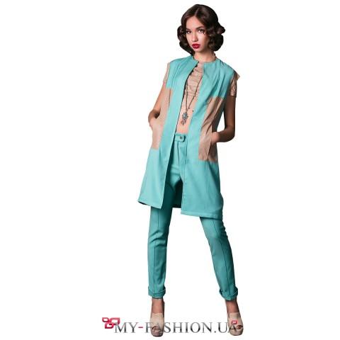 Узкие брюки цвета мяты со вставками из перфорированной кожи