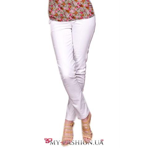 Белые облегающие дизайнерские джинсы