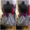Короткая полосатая юбка с ярким бантом