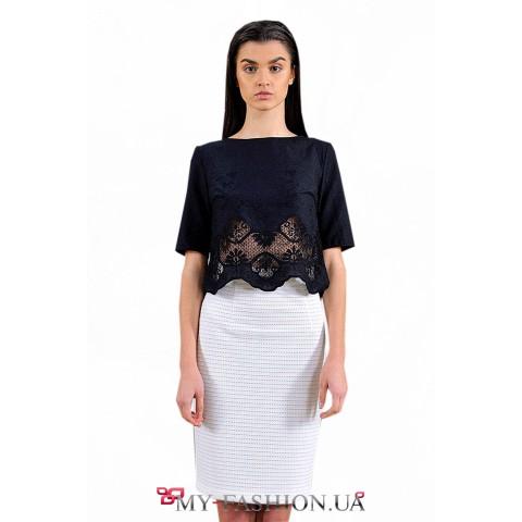 Блуза свободного силуэта с вышивкой по подолу