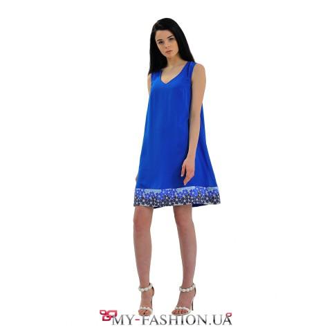 Короткое синее платье А-образного силуэта