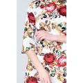 Короткое приталенное платье с ярким принтом