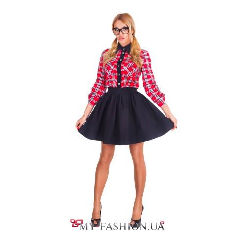 Короткая чёрная юбка расклешённой модели