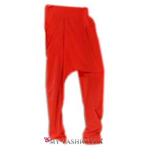 Красные брюки-шаровары с карманами