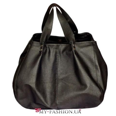 Черная кожаная сумка унисекс с металлическими кнопками на ручках